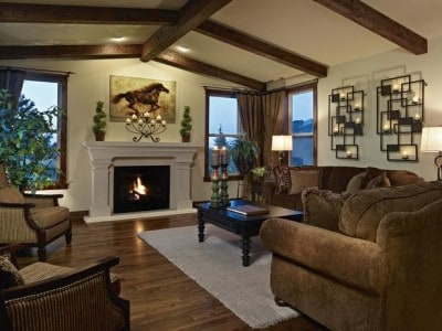 Living Room With Hardwood Flooring And Vaulted Ceilings