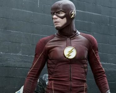 Grant Gustin in full uniform as the Flash